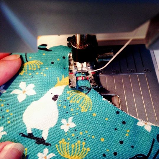 Cheeky cockatoo watching me as I top-stitch the bib